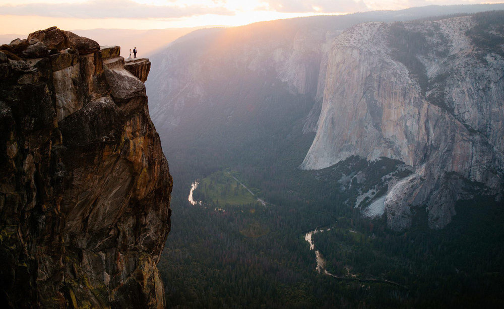 An elopement ceremony on the edge of a cliff on Taft Point by Yosemite elopement photographers Colby and Jess