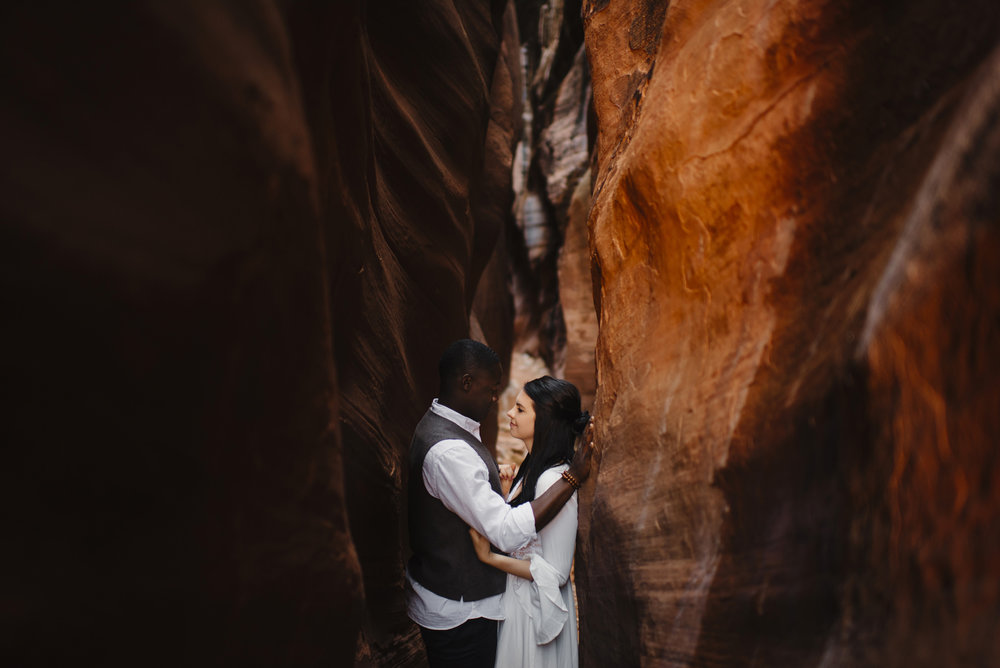 A couple looks into each others eyes during their Antelope Canyon Adventure Engagement Photography Session with Utah Destination Elopement Photographer Colby and Jess