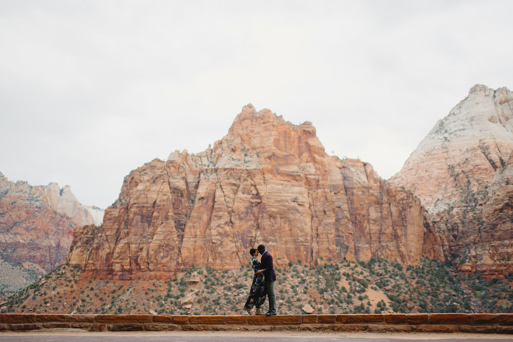 A couple in love during their Zion Engagement Photography Session with Zion National Park Utah Elopement Photographer Colby and Jess