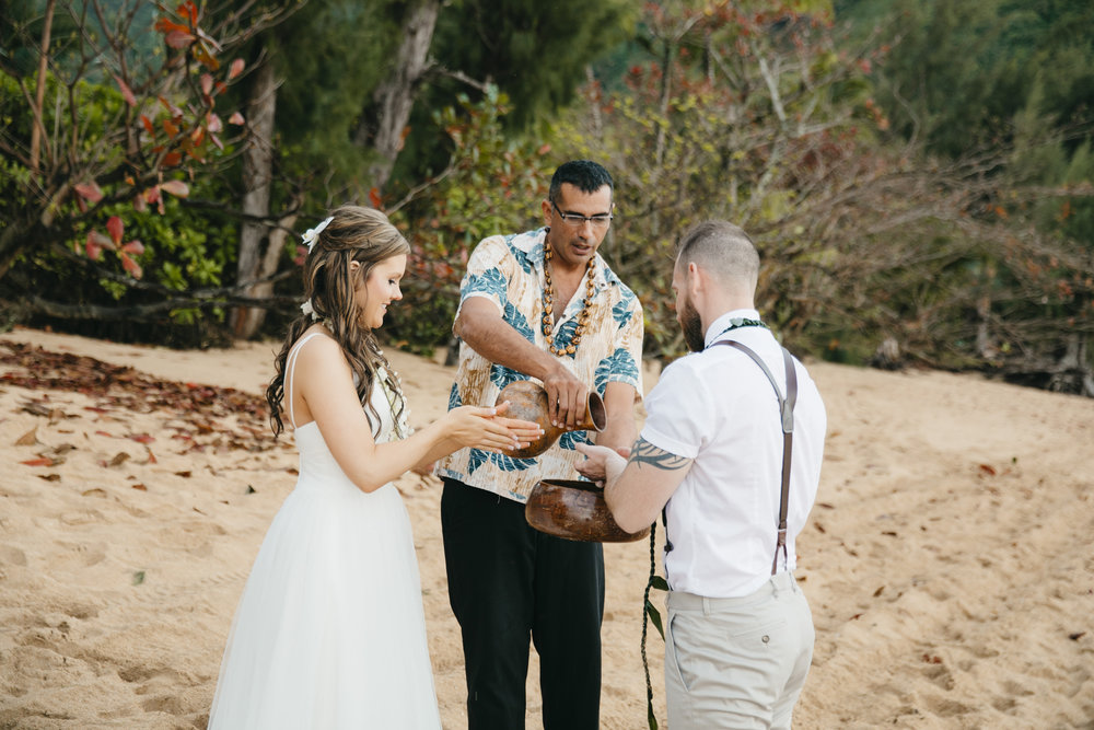 Wedding Ceremony at Tunnels Beach with Kauai Adventure Elopement photographers Colby and Jess