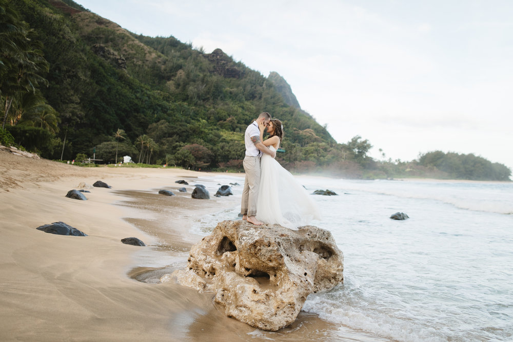 A bride and groom after their Tunnels beach wedding ceremony with Kauai Elopement Photographers Colby and Jess