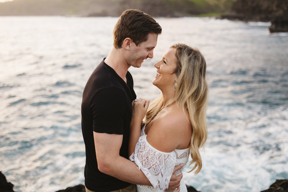 A lovely couple laughs during their adventure engagement session by Maui elopement Photographer Colby and Jess