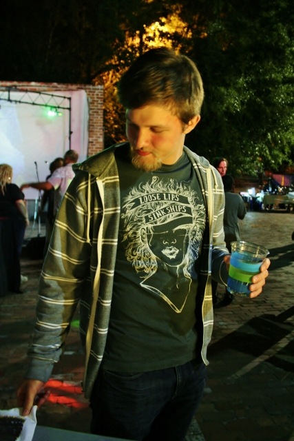 Local patron rocking our 'Loose Lips' reprint and checking out Luca Carey's newest design. Photo by Sinjin Hilaski