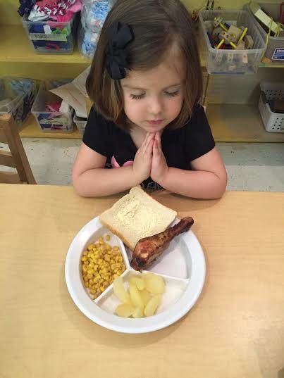 praying over lunch.jpg