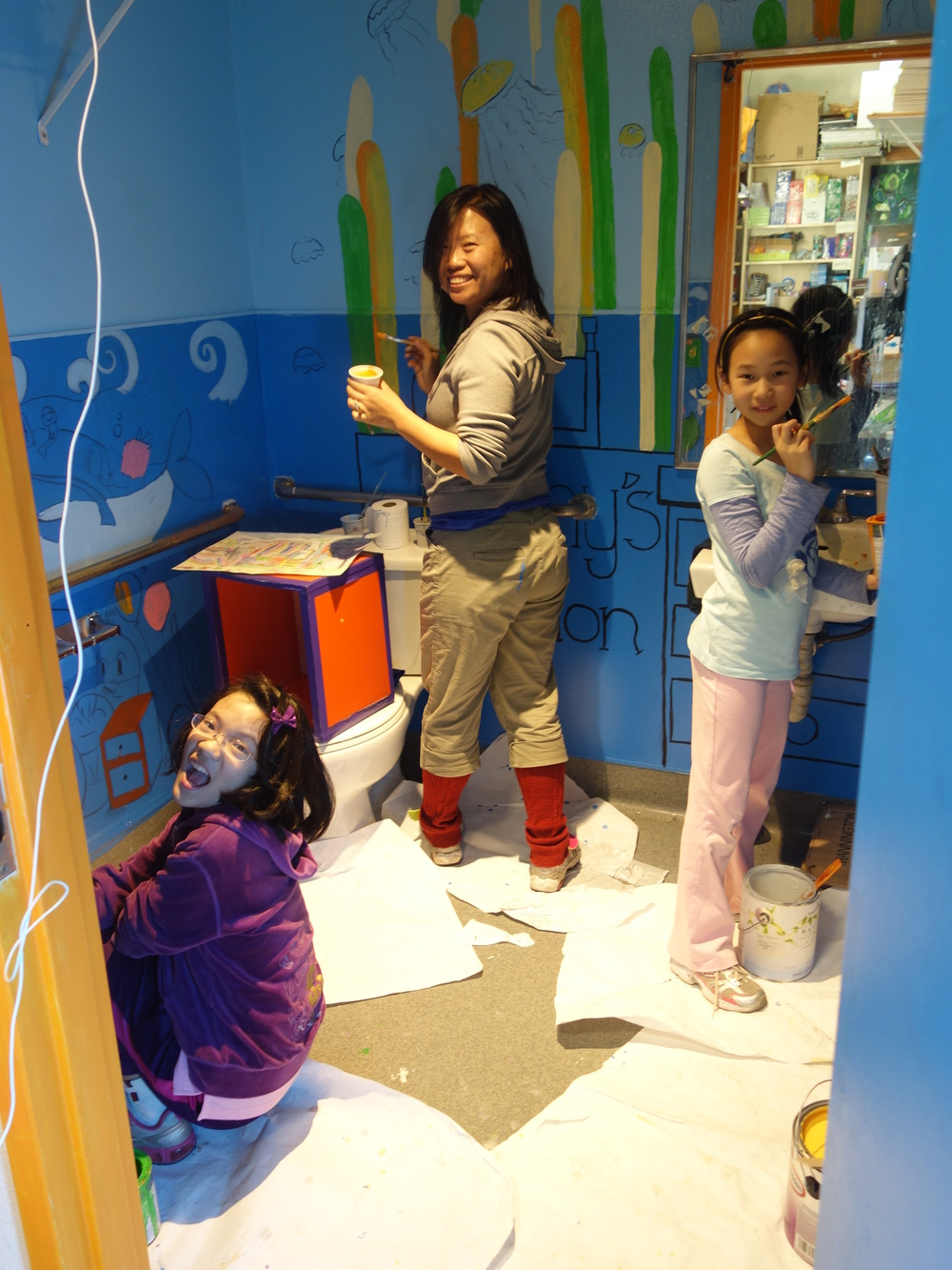 Landy, Kaelynn, and Hongyun repainting the bathroom at Hongyun Art