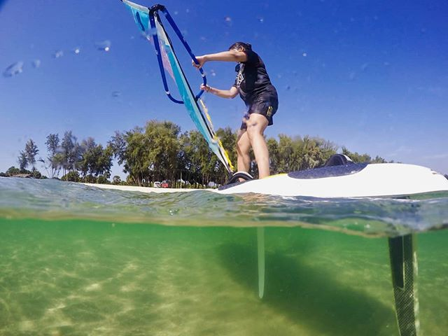 Clear blue skies and waters, let's windsurf!