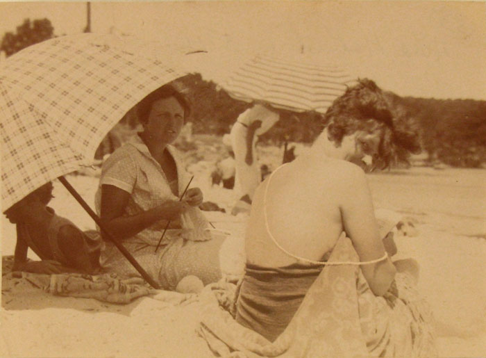 Sara Murphy, with her legendary pearls draped over her back for sunbathing, and Ada MacLeish (under umbrella), La Garoupe beach, Antibes, 1924