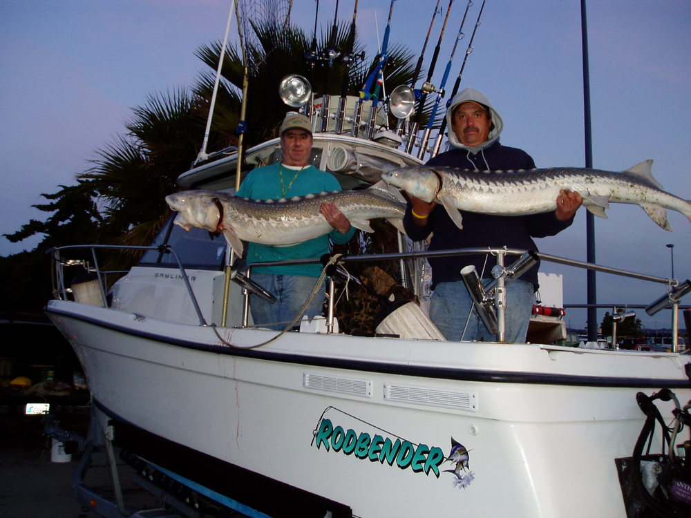 mike adn brad with sturgeon.JPG