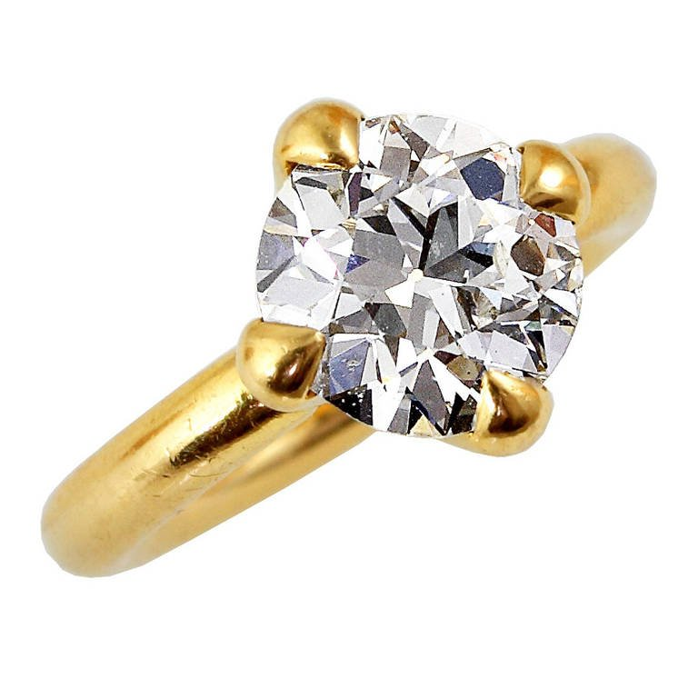 4+ CT. ROUND BRILLIANT AND GOLD RING, BY JAR PARIS
