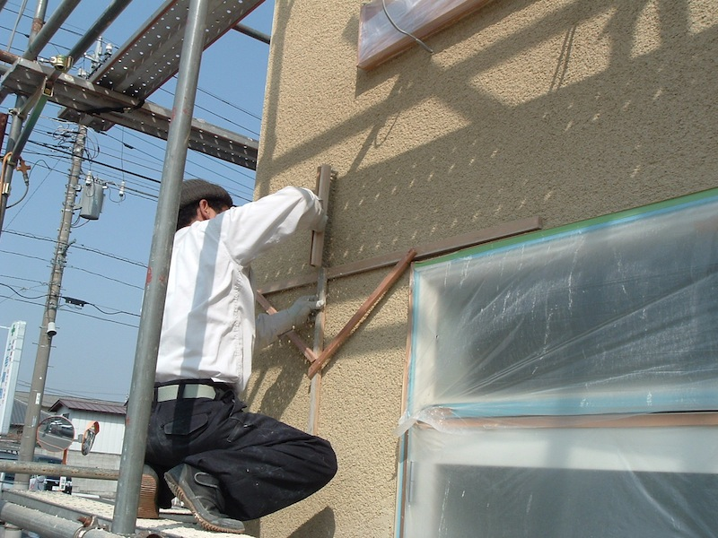 photo by Junko Yamamoto: Soton kabe (exterior wall made of volcanic ash) - he made his own tool to finish the surface.