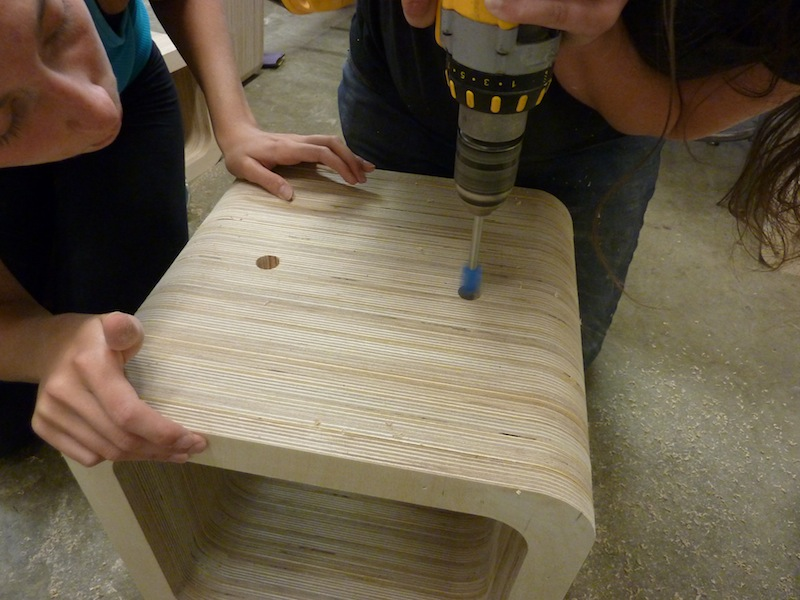 photo by Junko Yamamoto: creating the plug-in holes on actual pieces of furniture