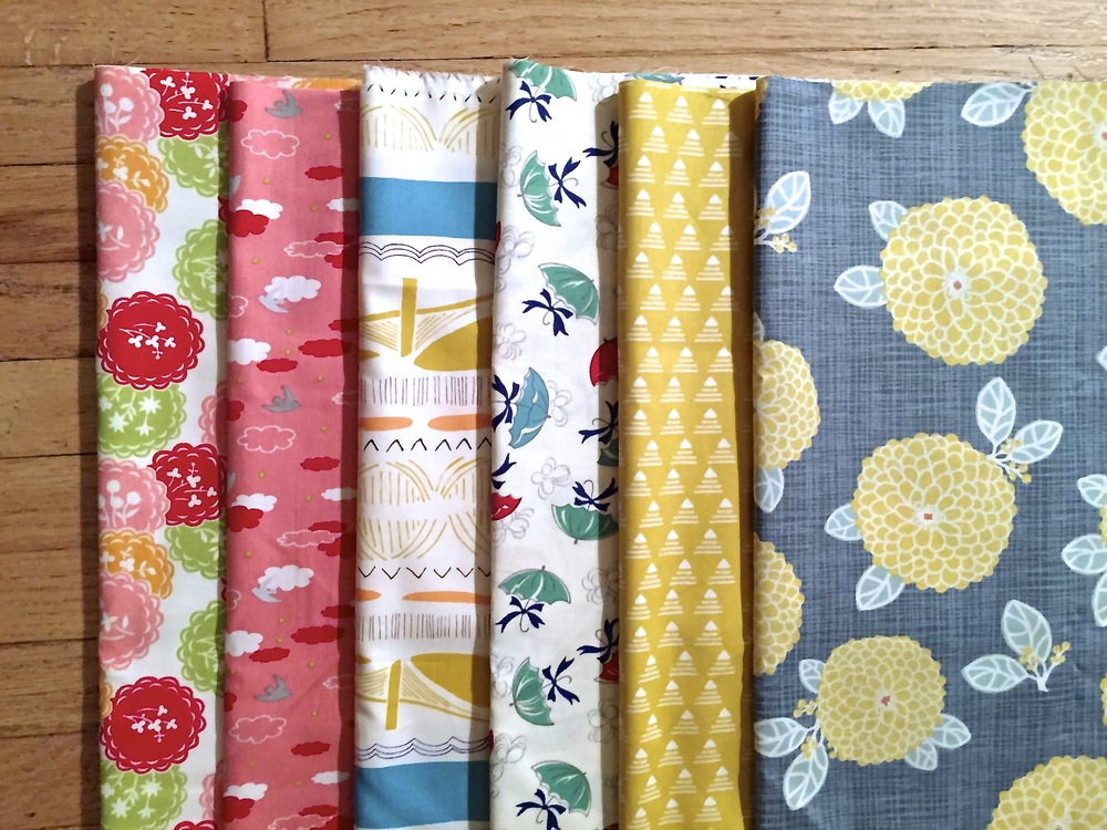 From left to right: Scrumptious by Bonnie & Camille for Moda; Anthology the Woodlands Cloud Bird; Leah Duncan for Gramercy Brooklyn Bridge; April Showers by Bonnie & Camille for Moda; Leah Duncan for Gramercy Commute by Taxi; Moda Autumn Woods by Kate & Birdie