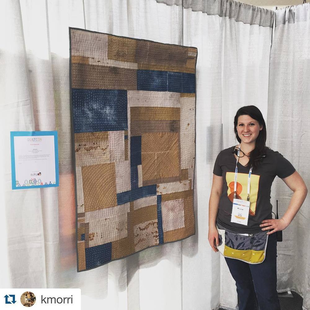 I love this picture because it shows my quilting work and my job! QuiltCon crew for life.