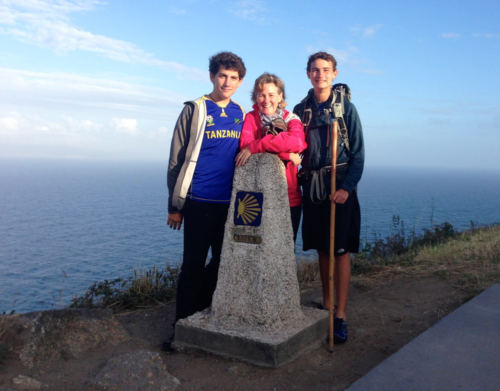 Amy with her sons Dan and Ryan at the end of El Camino in Santiago, Spain.