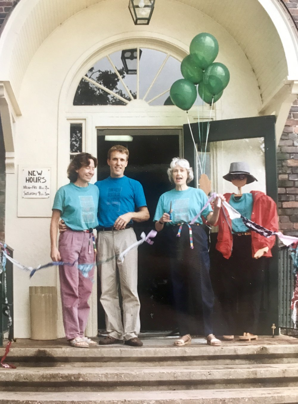 Audrey, Scott and Mayor Ellie Kinnaird cutting the ribbon on opening day, welcoming the very first customers into Townsend Bertram & Company! Four of the original TB&C tees modeled above.