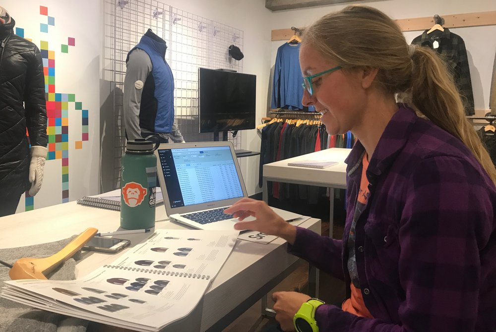 Erin studying the new Smartwool collection. #allaboutthebase yay for base layers!