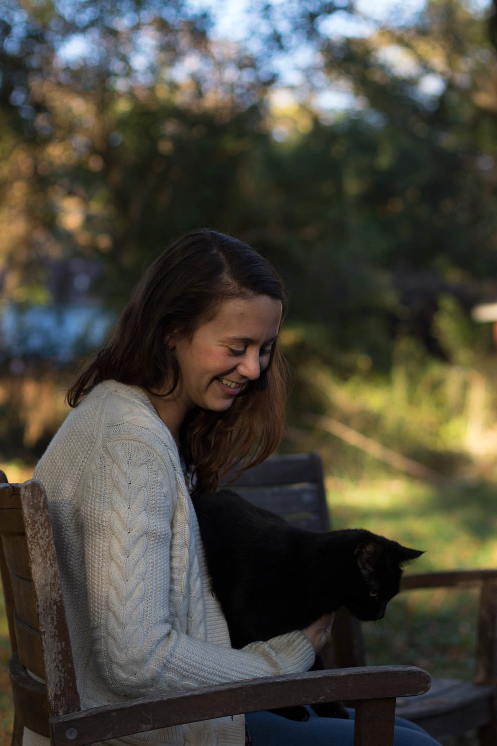 "Chadbourne says she loves to take breaks from making products and play with her cat.   ""I love my cat so much,"" Lizzie beams, ""Russell even built her a platform to help her climb onto the roof."""