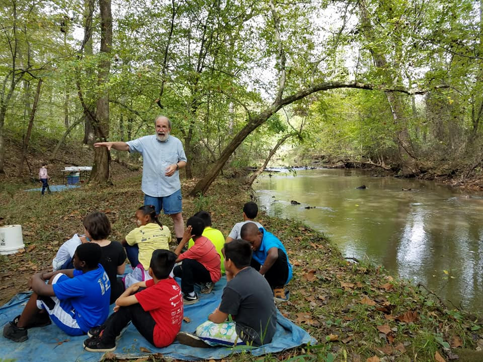 Volunteer John Wagner teaches 4th graders about pollution sensitive aquatic insects at our annual learning celebration.