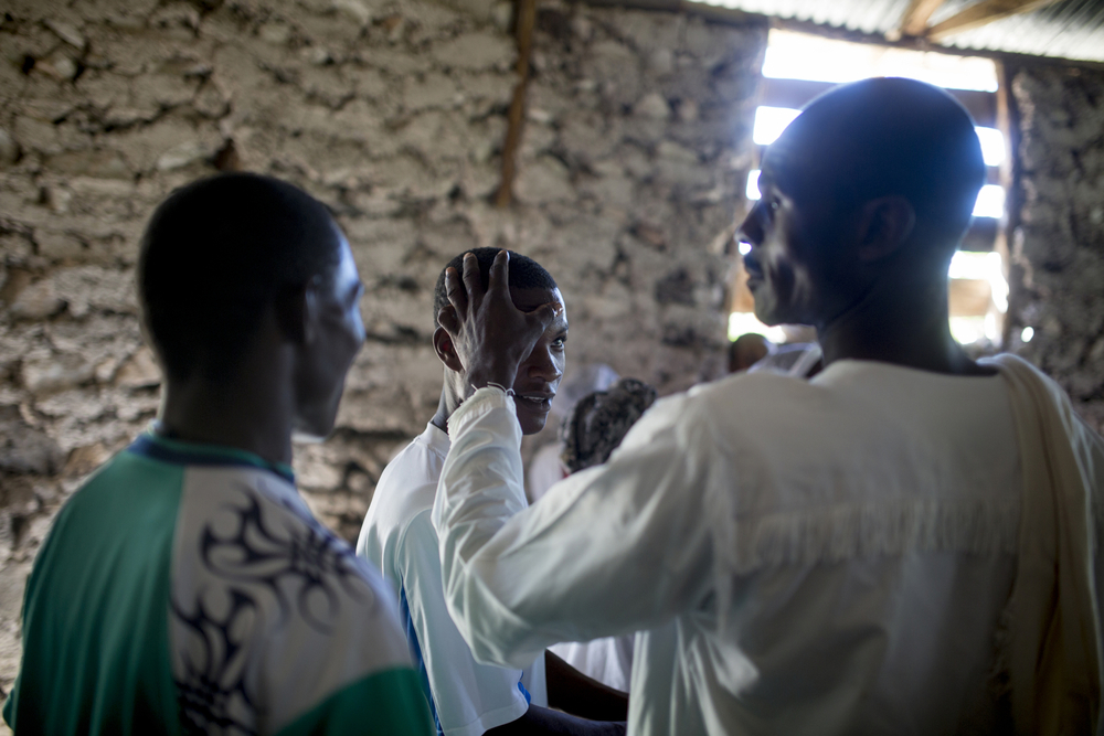 A pastor of a church in Les Forges, Haiti, anoints a parishioner with oil.