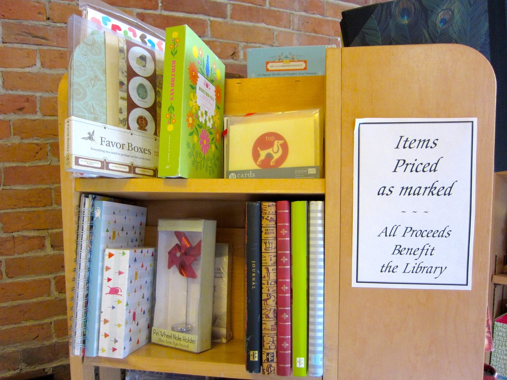 You can purchase a variety of new books, gifts, and cards donated to support the library