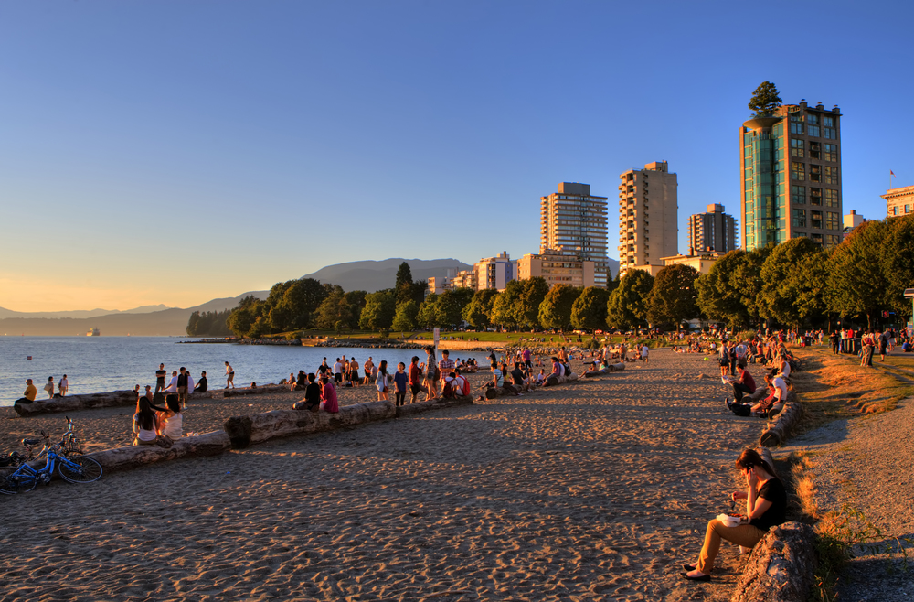 Vancouverites and tourists enjoying the sunset on the beach in English Bay.   Photo courtesy of Tourism Vancouver  |  Clayton Perry