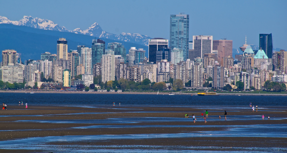 English Bay at low-tide from Kits Beach looking north to downtown. ~ Photo courtesy of  Tourism Vancouver/ Al Harvey