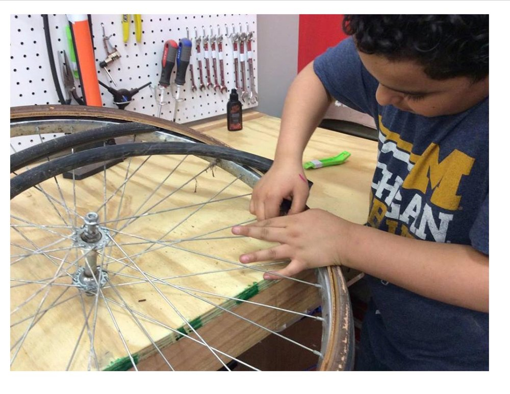 Working on Bike Wheel.jpg