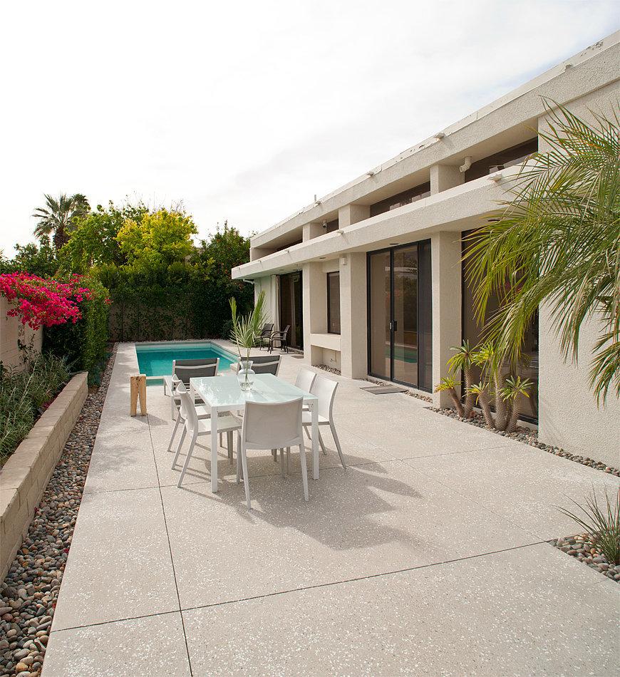 Cement-pebble-landscaping-enhances-home-modern-allure.jpg