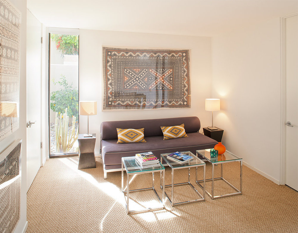 Framed-fabric-hung-above-sofa-provides-unexpected-twist.jpg