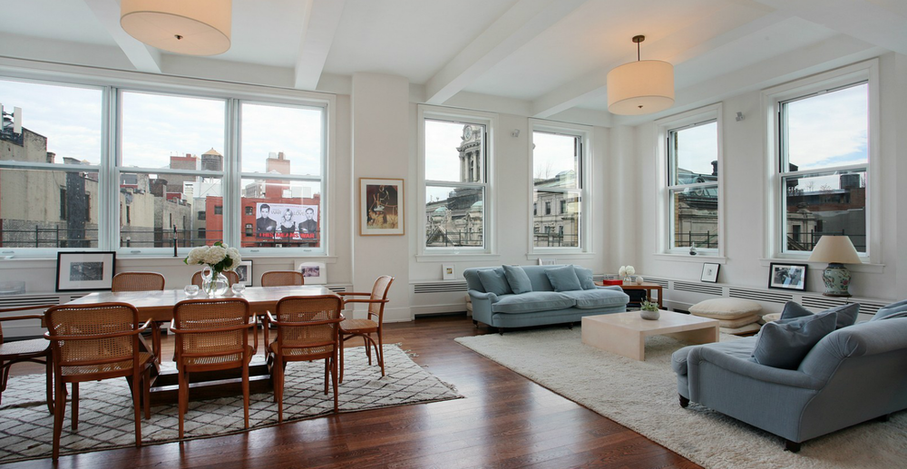 open-plan-loft-seamlessly-blends-living-room-seating-area.png