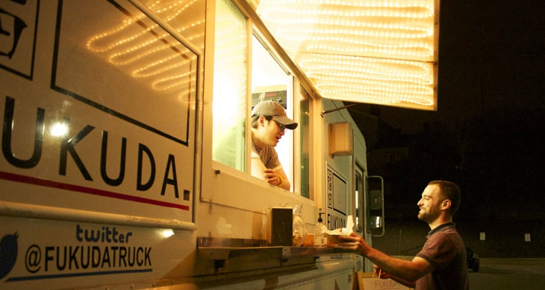 Hoon Kim greets a customer at Fuduka's mobile venue parked on Butler Street (a brick-and-mortar location is in Bloomfield).  Photo: Margaret J. Krauss