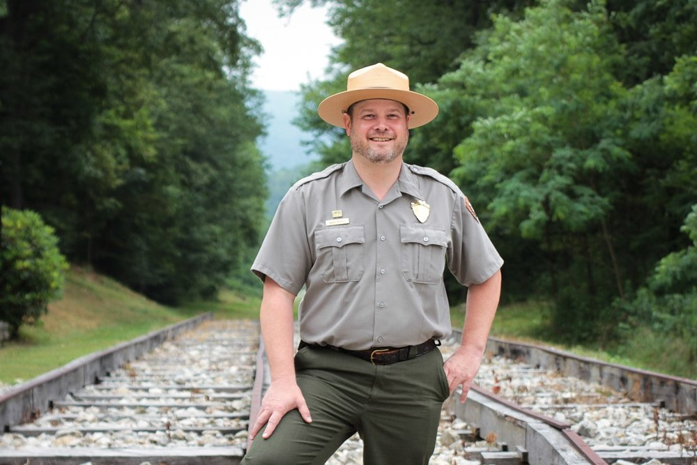Park ranger Doug Bosley stands on a stretch of railroad track that was vital to the Pennsylvania Mainline Canal System. Photo: Margaret J. Krauss