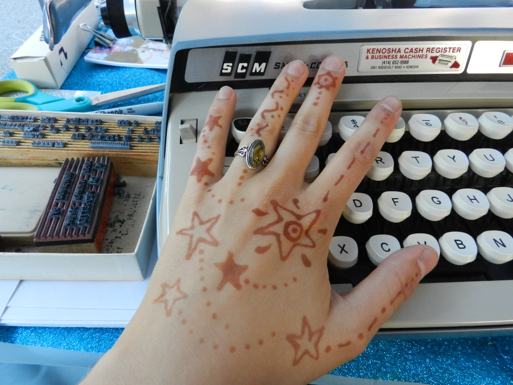 Renee Bebeau prepared my hands with cosmic henna for optimal space transcription.