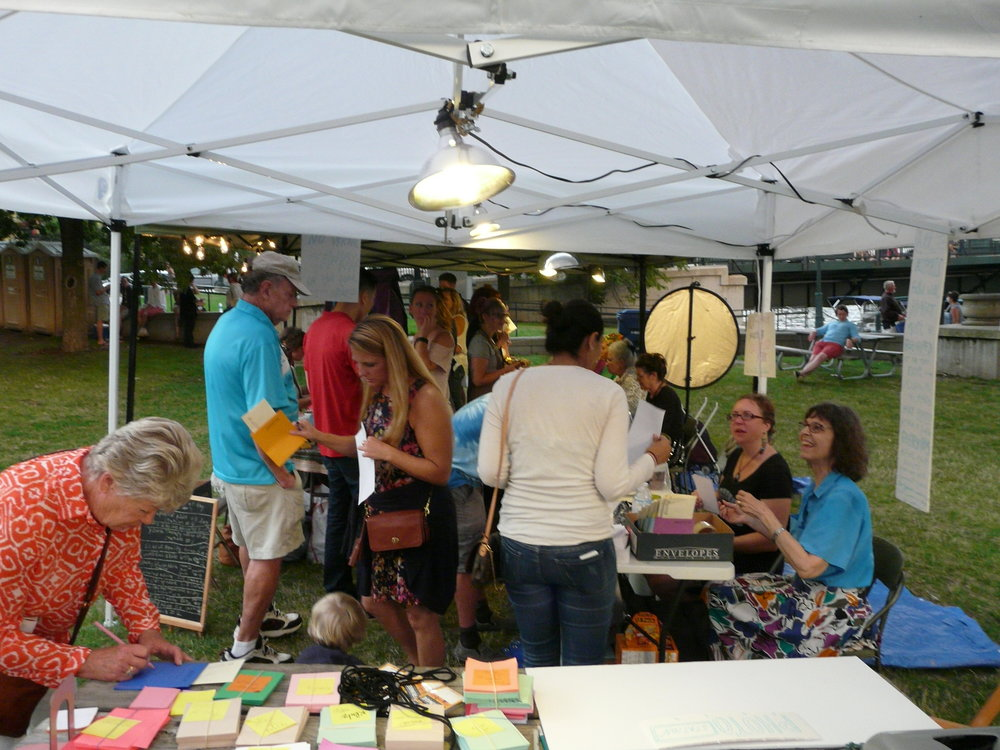 "Volunteers at the entrance would help participants select one question to receive advice on.  The question would then be written down on the cover of each participants issued ""advice passport"" so they could show their question to each advisor without breaking the ""no talking in the tent"" rule."
