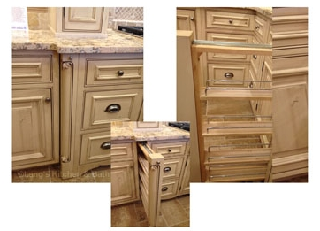 Kitchen cabinet with pull-out pantry for spice storage.