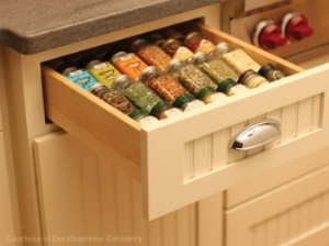 Kitchen cabinet with spice drawer.