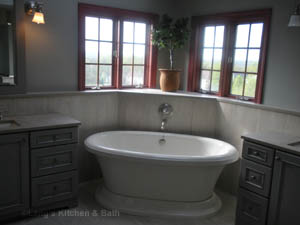 Traditional style bathroom design with freestanding tub.