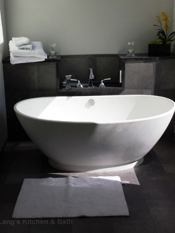 Freestanding tub provides a focal point for this transitional style bathroom design.