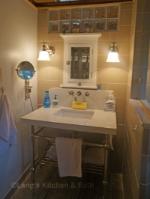 Bathroom design with a small vanity top countertop.