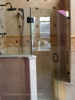 Bathroom design with custom frameless glass shower.