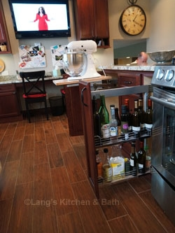 Kitchen design in Newtown, PA with specialized pull out kitchen cabinet shelves including storage for a KitchenAid mixer.