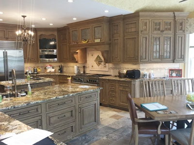 Kitchen design in New Hope, PA with porcelain tile floors, granite countertops, and stone tile backsplash.