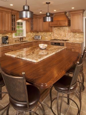 Kitchen design in Newtown, PA with pendant lights over the island.