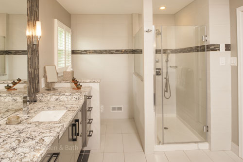 Bathroom design in Newtown, PA featuring white bathroom fixtures.