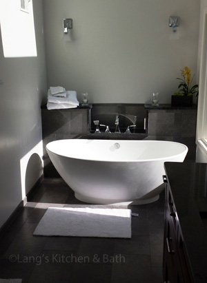 Transitional bathroom design with freestanding bathtub.