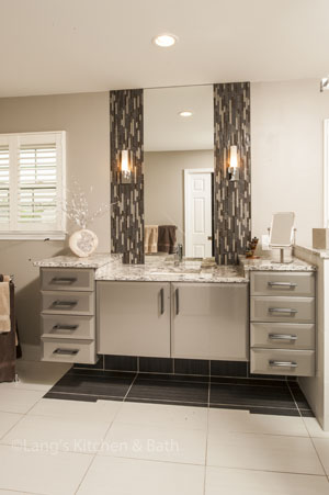 Contemporary bathroom design with dark accent tiles.