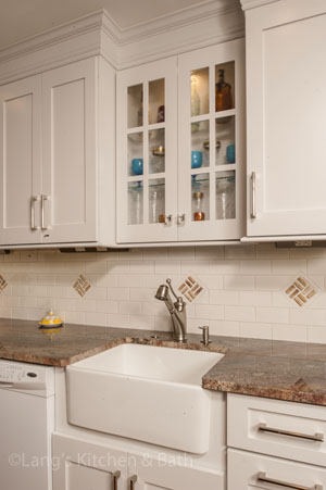 traditional kitchen design in Yardley, PA with farmhouse sink and glass door cabinets