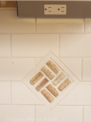 Kitchen design with cork inlaid in the white backsplash.