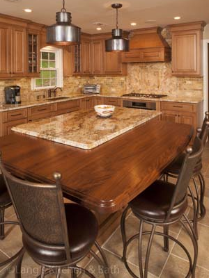 Kitchen design in Newtown, PA with a butcher block and granite island countertop.