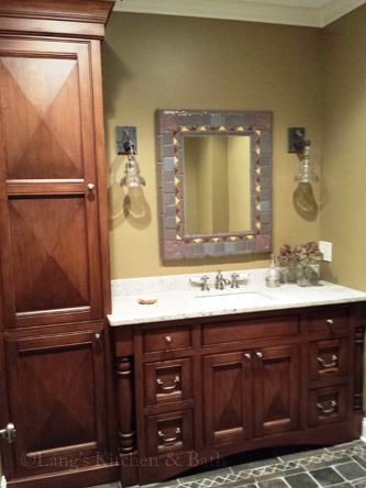 Bathroom design with a one-of-a-kind mirror framed by tiles from the Moravian Tile Works.